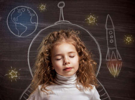 astronaut: beauty child at the blackboard Stock Photo