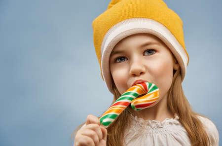 little girl eats a candy bar Stock Photo