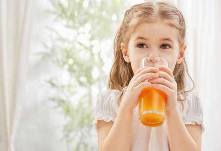 A beautiful girl drinking fresh juice Banco de Imagens