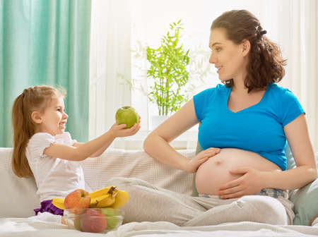 pregnant girl: happy pregnant woman with her child