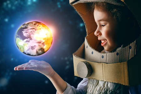 child is dressed in an astronaut costume Banco de Imagens - 38265855