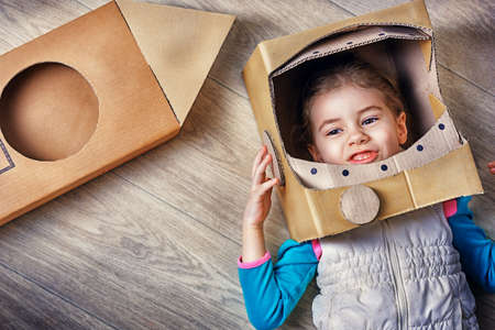cardboard box: child is dressed in an astronaut costume