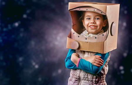 children  play: child is dressed in an astronaut costume