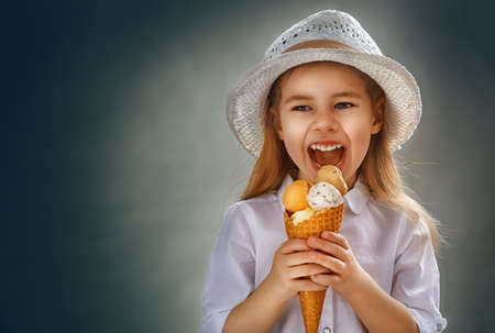 little girl eating ice cream Stock Photo