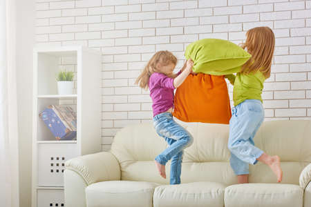 pillow fight: happy friends having fun together
