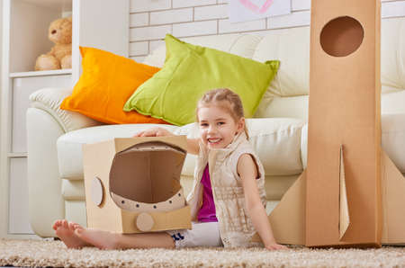 child rocket: a child plays in the astronaut