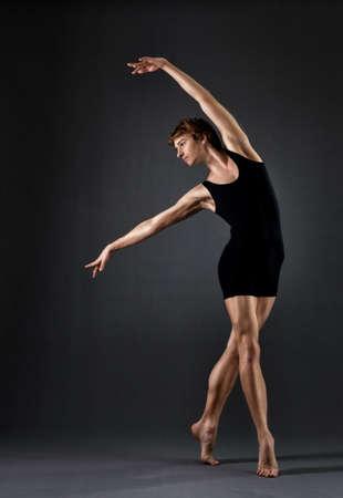 male ballet dancer: modern ballet dancer on black background