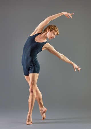 male ballet dancer: modern ballet dancer on grey background