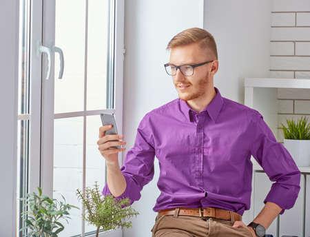businessman phone: Businessman  talking on his mobile phone