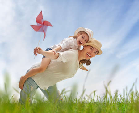 lifestyle outdoors: happy mother and child together