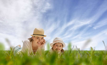 sky and grass: happy mother and child together