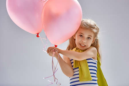 pink balloons: little girl holding pink balloons