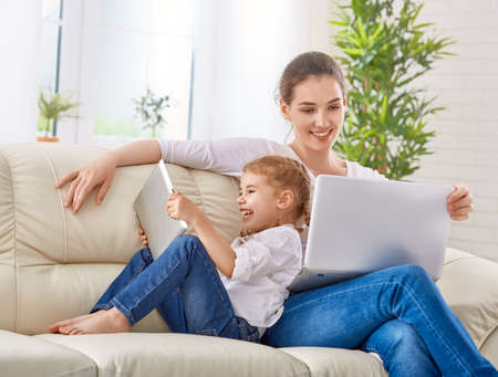 computer learning: happy mother and child together