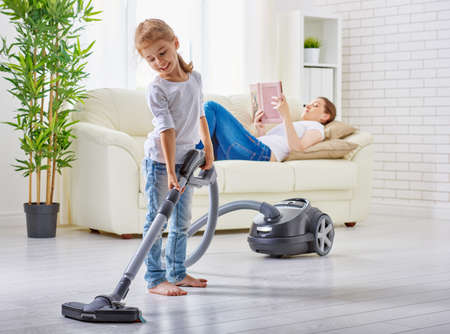 family  room: happy family cleans the room