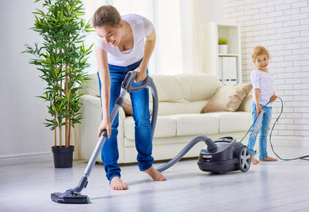 vacuum: happy family cleans the room