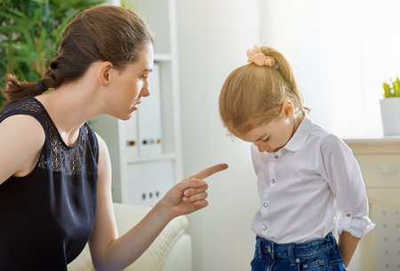 child: mother scolds her child Stock Photo