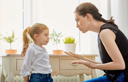 domestic: mother scolds her child Stock Photo