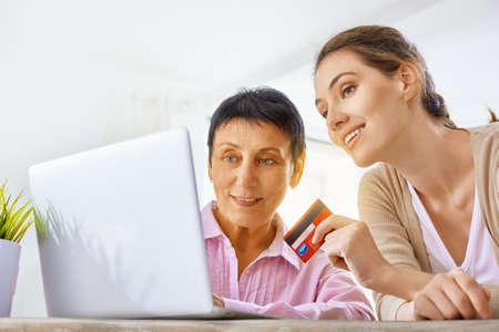 a women doing online shopping Stock Photo