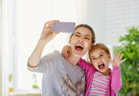mothers hand: mother and daughter making a selfie Stock Photo
