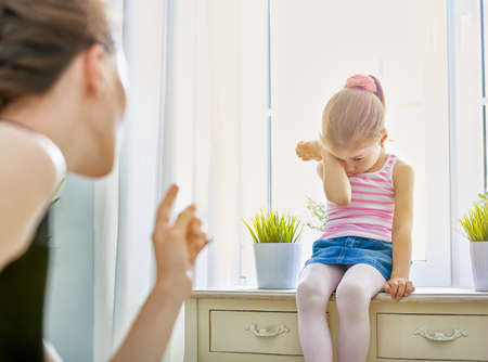 parenthood: mother scolds her child Stock Photo