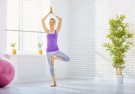 woman pose: beautiful girl is engaged in yoga Stock Photo