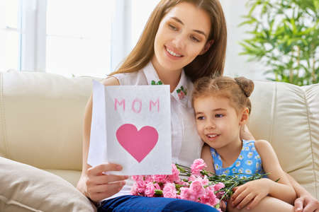 mother: mother and daughter with flowers Stock Photo