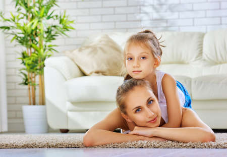 woman on couch: happy mother with her child