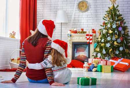 holiday house: Mother and daughter making preparations for Christmas Stock Photo