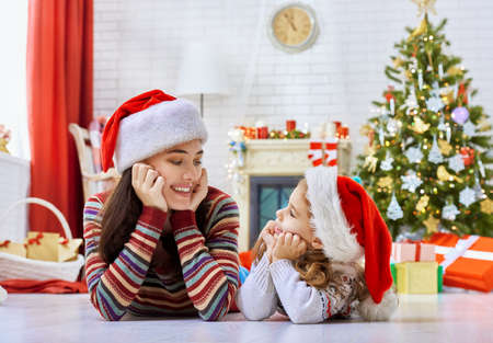 fireplace family: Mother and daughter making preparations for Christmas Stock Photo