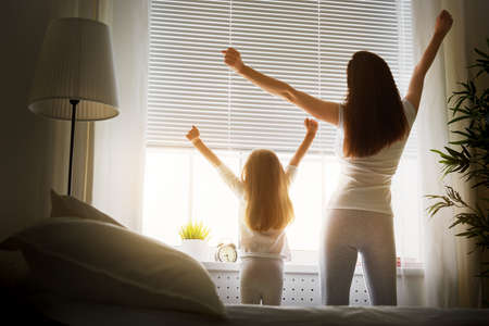 mother and daughter enjoying sunny morning Stockfoto
