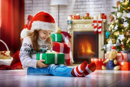 christmas gift: Girl sitting with Christmas gift