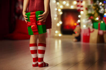Hands of little girl with Christmas present