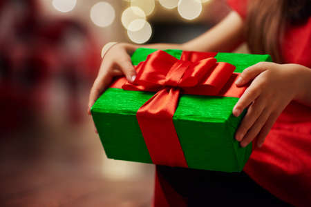 surprise box: Hands of little girl with Christmas present