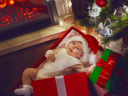 tiny: Tiny baby lying in a Christmas gift box