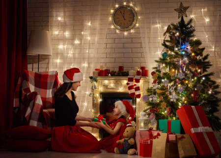 christmas gifts: Mother and daughter exchanging Christmas gifts