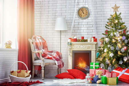 fireplace living room: A beautiful living room decorated for Christmas. Stock Photo