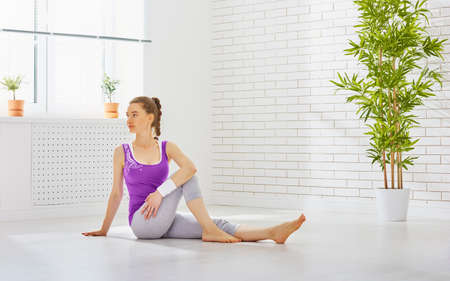 position: beautiful girl is engaged in yoga Stock Photo