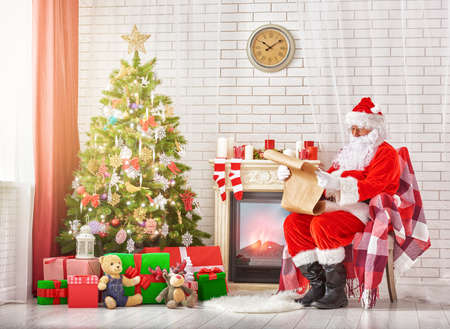 morning light: Portrait of Santa Claus sitting at his room at home near Christmas tree