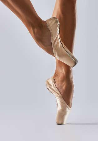 Ballerina: Ballerina dancing on point in studio Stock Photo