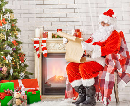 decorated: Portrait of Santa Claus sitting at his room at home near Christmas tree