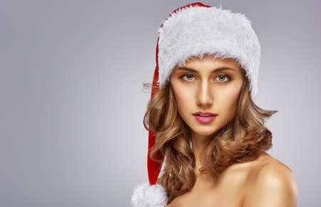 elegant girl: Beautiful sexy woman in Santas hat.