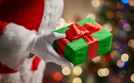 christmas present: Hands of Santa Claus with Christmas present Stock Photo