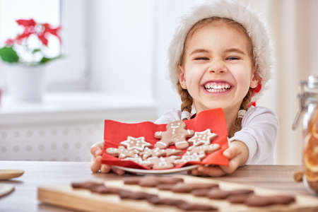 dessert: little girl cooking Christmas biscuits