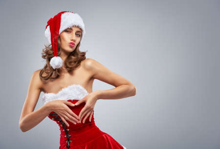 woman surprise: Beautiful sexy woman in Santas hat.