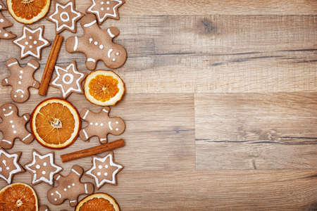 orange man: Gingerbread on wooden background