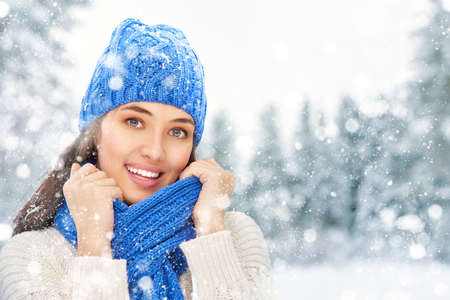 christmas time: Happy young woman on a winter walk in nature.