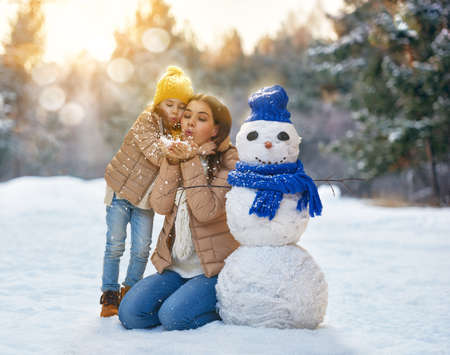 mother nature: Happy family! Mother and child girl on a winter walk in nature. Stock Photo