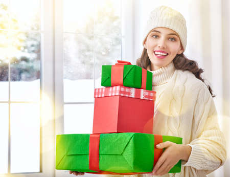 woman shop: Beautiful young woman with gift boxes