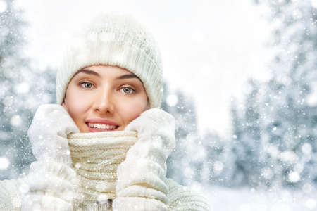 snow forest: Happy young woman on a winter walk in nature.