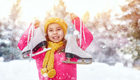 winter vacation: cute little girl is going skate outdoors